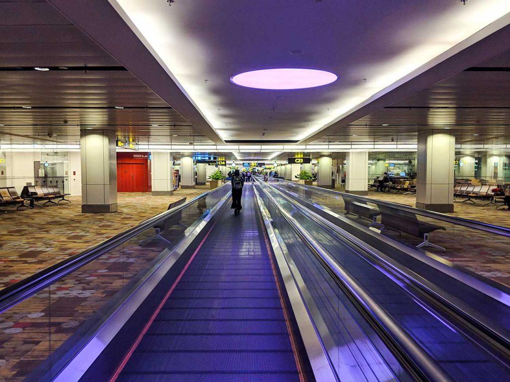 Singapore Changi Airport: Has many travelators or moving sidewalks